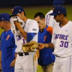 Pitcher Danny Young (15) gets hit by a ball hit by a Tennessee batter during Friday's game. The Gators defeated the Vols 7-2 Friday night.
