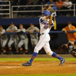 Vickash Ramjit (30) gets on first base Friday night. The Gators defeated the Vols 7-2 Friday night.
