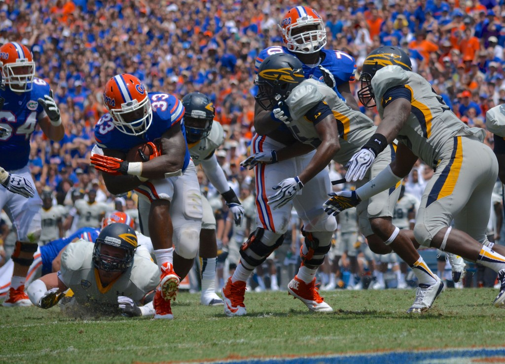Florida offensive tackle DJ Humphries paves the way for running back Mack Brown against Toledo. Humphries will miss 2-4 weeks with a sprained MCL.