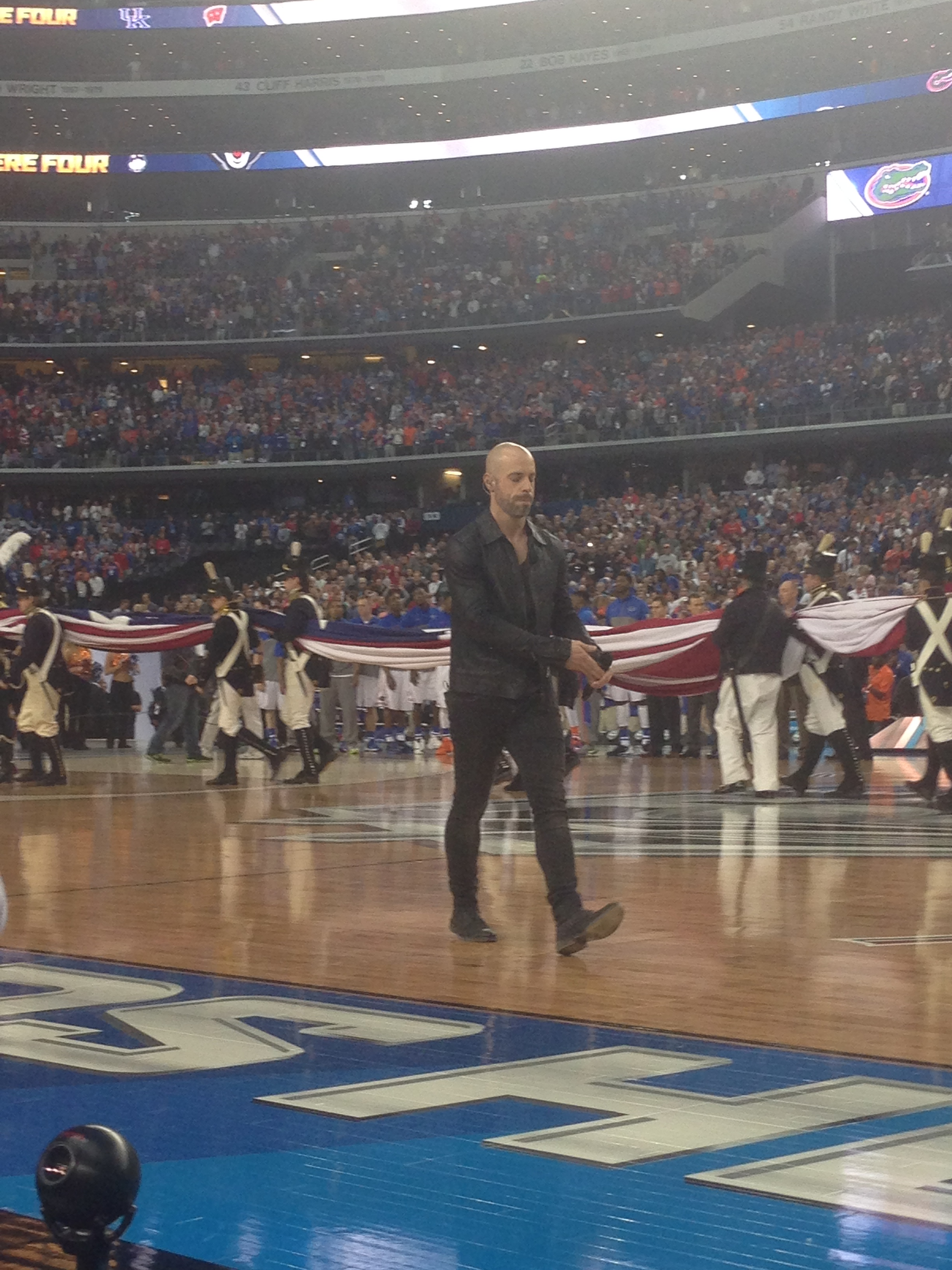 Artist Chris Daughtry heading off the court after performing the national anthem.