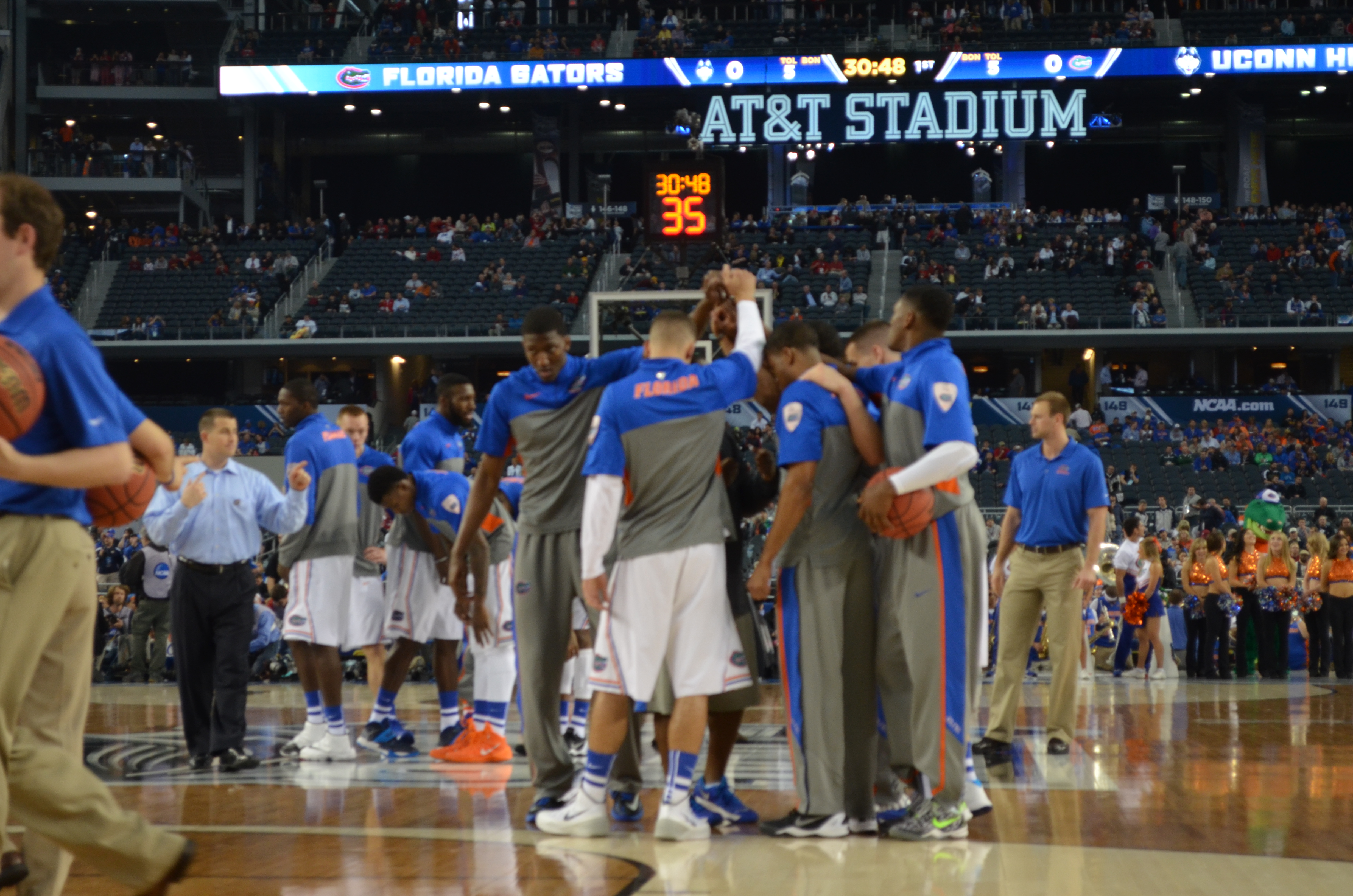 Gators huddle up at the end of shoot around, as they get ready to tip off vs. UConn