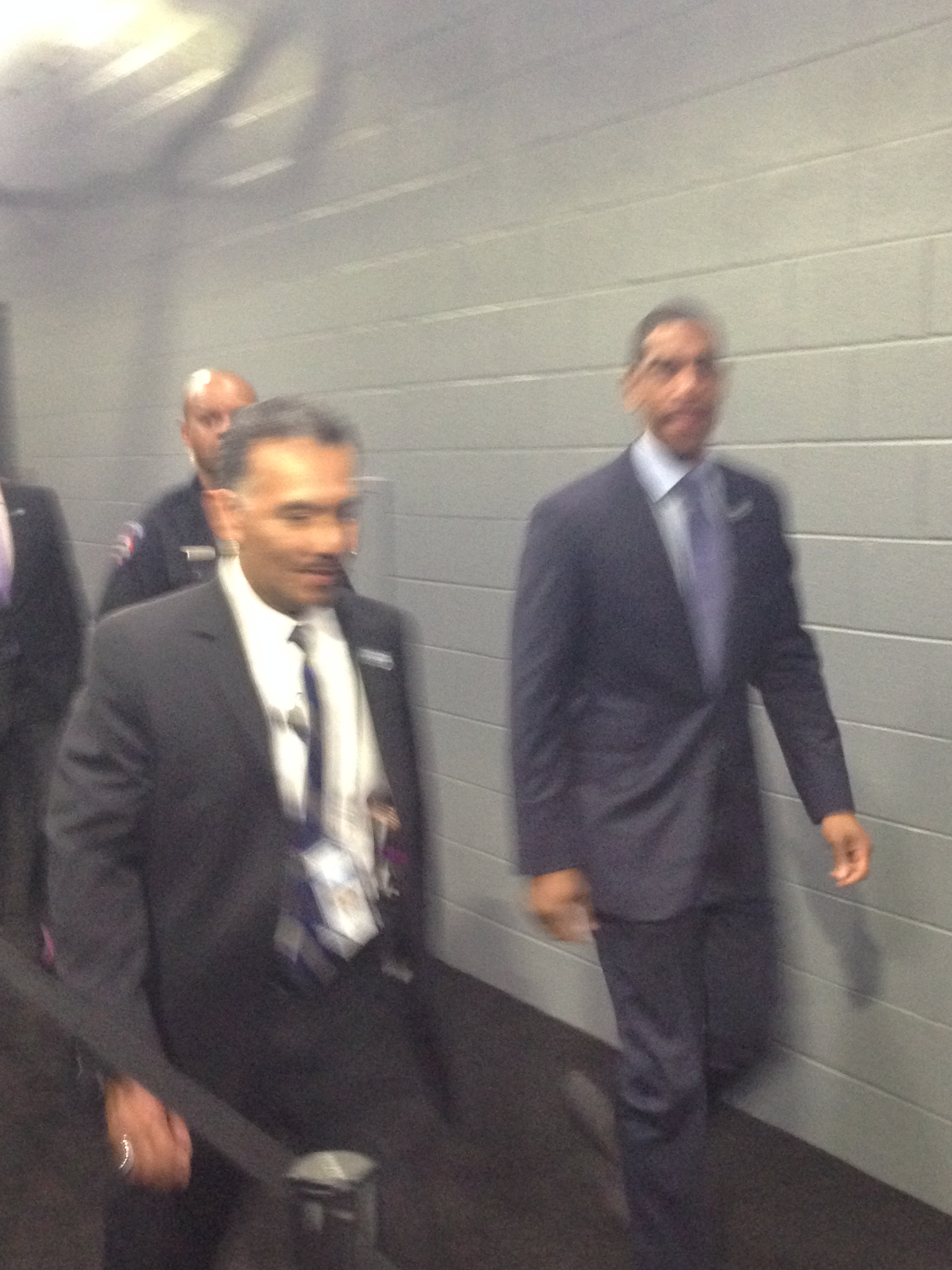 UConn head coach Kevin Ollie coming from locker room