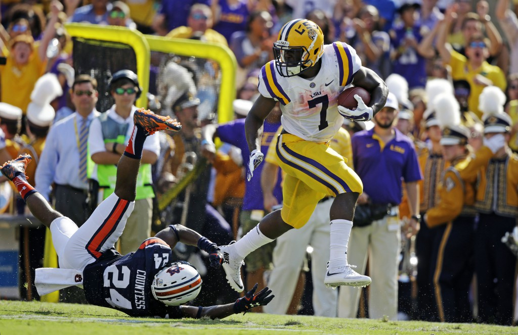 LSU running back Leonard Fournette (7) eludes Auburn defensive back Blake Countess (24) on a 40 hard touchdown run in the first half of an NCAA college football game in Baton Rouge, La., Saturday, Sept. 19, 2015. (AP Photo/Gerald Herbert)