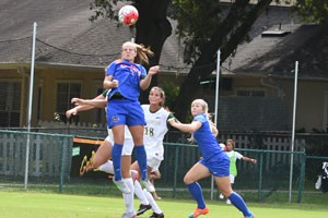 Savannah Jordan goes up for header in Gators 3-2 loss on Sunday