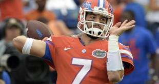 FILE - In this Oct. 3, 2015, file photo, Florida quarterback Will Grier warms up before an NCAA college football game against Mississippi in Gainesville, Fla. A person familiar with the situation says Grier has been suspended indefinitely for violating the NCAA's policy on banned drugs. The person spoke to The Associated Press on condition of anonymity because the school has not announced the decision. Grier is considering an appeal. (AP Photo/Phelan M. Ebenhack, File)