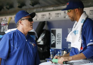Toronto Blue Jays manager John Gibbons, left, talks with starting pitcher David Price, right, in the dugout during a baseball game against the Texas Rangers Thursday, Aug. 27, 2015, in Arlington, Texas. (AP Photo/Tony Gutierrez)