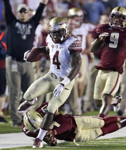 FILE - In this Sept. 18, 2015, file photo, Florida State running back Dalvin Cook (4) tries to outrun Boston College defensive back Justin Simmons (27) and defensive back John Johnson (9) during the first half of an NCAA college football game in Boston. Florida State's Dalvin Cook and Miami's Joseph Yearby are the top two running backs in the Atlantic Coast Conference who once shared the same backfield at Miami Central High School. (AP Photo/Charles Krupa, File)