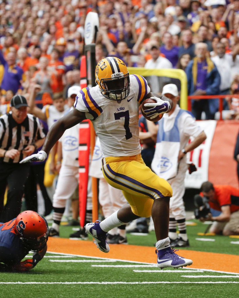 LSU running back Leonard Fournette (7) runs for a touchdown during the first half of an NCAA college football game against Syracuse on Saturday, Sept. 26, 2015, in Syracuse, N.Y. (AP Photo/Mike Groll)