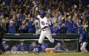Chicago Cubs center fielder Dexter Fowler (24) runs bases after hitting a home run against the St. Louis Cardinals during the eighth inning of Game 3 in baseball's National League Division Series, Monday, Oct. 12, 2015, in Chicago. (AP Photo/Nam Y. Huh)