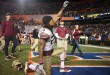 FSU linebacker Terrance Smith (24) cuts grass from the Flordia endzone and holds it up toward the crowd after his team defeats their rivals 27-2. (Greenberry Taylor/ WUFT News)