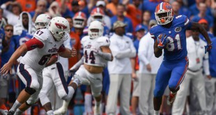During a punt return, Florida wide receiver Antonio Callaway (81) speeds past FAU punter Dalton Schomp (67) for 52-yards in the first half. (Greenberry Taylor/ WUFT News)