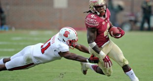 Nov 14, 2015; Tallahassee, FL, USA; Florida State Seminoles running back Dalvin Cook (4) runs the ball past North Carolina State Wolfpack cornerback Juston Burris (11) during the second half of the game at Doak Campbell Stadium. Mandatory Credit: Melina Vastola-USA TODAY Sports