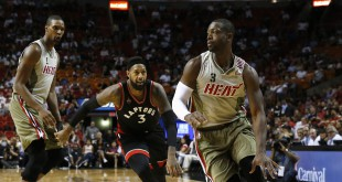 Nov 8, 2015; Miami, FL, USA;  Miami Heat guard Dwyane Wade (3) dribbles the ball as Toronto Raptors forward James Johnson (3) defends as forward Chris Bosh (1) looks on in the second half at American Airlines Arena. The Heat won 96-76. Mandatory Credit: Robert Mayer-USA TODAY Sports
