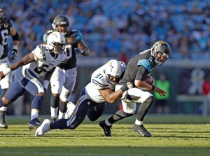 Nov 29, 2015; Jacksonville, FL, USA; San Diego Chargers defensive end Kendall Reyes (91) tackles Jacksonville Jaguars quarterback Blake Bortles (5) in the fourth quarter at EverBank Field. The Chargers won 31-25. Mandatory Credit: Jim Steve-USA TODAY Sports