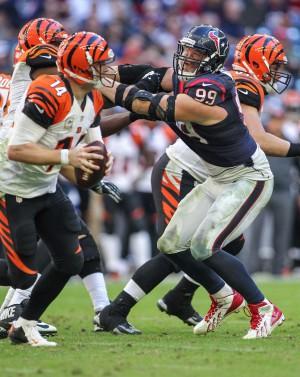 Nov 23, 2014; Houston, TX, USA; Houston Texans defensive end J.J. Watt (99) applies pressure to Cincinnati Bengals quarterback Andy Dalton (14) during the game at NRG Stadium. Mandatory Credit: Troy Taormina-USA TODAY Sports