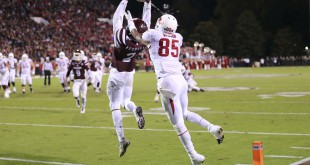 Nov 1, 2014; Starkville, MS, USA; Mississippi State Bulldogs defensive back Will Redmond (2) grabs the ball for an interception against Arkansas Razorbacks wide receiver Demetrius Wilson (85) at Davis Wade Stadium. Mississippi State Bulldogs defeat the Arkansas Razorbacks 17-10.  Mandatory Credit: Spruce Derden-USA TODAY Sports