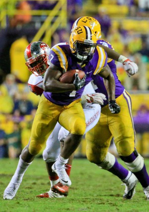 Oct 24, 2015; Baton Rouge, LA, USA; LSU Tigers running back Leonard Fournette (7) runs against the Western Kentucky Hilltoppers during the fourth quarter of a game at Tiger Stadium. LSU defeated Western Kentucky 48-21. Mandatory Credit: Derick E. Hingle-USA TODAY Sports