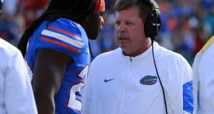 Oct 31, 2015; Jacksonville, FL, USA; Florida Gators head coach Jim McElwain talks with defensive back Marcell Harris (26) against the Georgia Bulldogs during the first quarter at EverBank Stadium. Mandatory Credit: Kim Klement-USA TODAY Sports