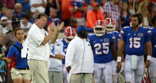 Oct 31, 2015; Jacksonville, FL, USA; Florida Gators head coach Jim McElwain claps his hands on the sidelines against the Georgia Bulldogs  during the second half at  EverBank Stadium. Florida Gators defeated the Georgia Bulldogs 27-3. Mandatory Credit: Kim Klement-USA TODAY Sports