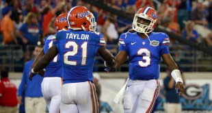 Oct 31, 2015; Jacksonville, FL, USA; Florida Gators running back Kelvin Taylor (21) and quarterback Treon Harris (3) congratulate each other as they scored a touchdown against the Georgia Bulldogs during the second half at EverBank Stadium. Florida Gators defeated the Georgia Bulldogs 27-3. Mandatory Credit: Kim Klement-USA TODAY Sports