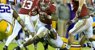 Nov 7, 2015; Tuscaloosa, AL, USA; Alabama Crimson Tide running back Derrick Henry (2) runs the ball past LSU Tigers defense during the fourth quarter at Bryant-Denny Stadium. Alabama won 30-16. Mandatory Credit: Marvin Gentry-USA TODAY Sports