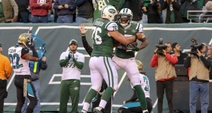 Nov 8, 2015; East Rutherford, NJ, USA; New York Jets wide receiver Brandon Marshall (15) celebrates with center Wesley Johnson (76) during the second half of the NFL game against the Jacksonville Jaguars at MetLife Stadium. The Jets won, 28-23. Mandatory Credit: Vincent Carchietta-USA TODAY Sports
