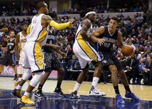 Nov 9, 2015; Indianapolis, IN, USA; Orlando Magic forward Aaron Gordon (00) drives baseline against Indiana Pacers center Jordan Hill (27) and guard Monta Ellis (11) at Bankers Life Fieldhouse. Mandatory Credit: Brian Spurlock-USA TODAY Sports
