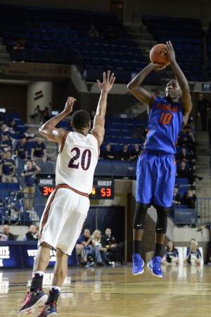 Nov 13, 2015; Annapolis, MD, USA; Florida Gators forward Dorian Finney-Smith (10) shoots over Navy Midshipmen guard Shawn Anderson (20) during the second half of the Veterans Classic at Alumni Hall. Florida Gators defeated Navy Midshipmen 59-41. Mandatory Credit: Tommy Gilligan-USA TODAY Sports
