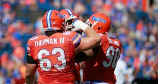 Nov 7, 2015; Gainesville, FL, USA; Florida Gators offensive lineman Trip Thurman (63), defensive lineman Jonathan Bullard (90) and  defensive lineman Alex McCalister (14) huddle up prior to the game against the Vanderbilt Commodores at Ben Hill Griffin Stadium. Mandatory Credit: Kim Klement-USA TODAY Sports