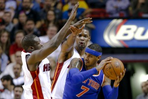Nov 23, 2015; Miami, FL, USA; New York Knicks forward Carmelo Anthony (right) is pressured by Miami Heat forward Luol Deng (left) and Miami Heat forward Chris Bosh (center) during the second half at American Airlines Arena. The Heat won 95-78. Mandatory Credit: Steve Mitchell-USA TODAY Sports