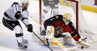 Nov 23, 2015; Sunrise, FL, USA;  Florida Panthers goalie Roberto Luongo (1) makes a save on a shot by Los Angeles Kings center Andy Andreoff (15) in the third period at BB&T Center. The Kings won 3-1. Mandatory Credit: Robert Mayer-USA TODAY Sports