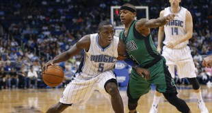Nov 29, 2015; Orlando, FL, USA; Orlando Magic guard Victor Oladipo (5) drives into Boston Celtics guard Isaiah Thomas (4) during the second half of a basketball game at Amway Center.  The Magic won 110-91. Mandatory Credit: Reinhold Matay-USA TODAY Sports