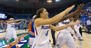 Senior guard Carlie Needles with teammates after a win over FSU. Courtesy of @gatorswbk via Instagram.