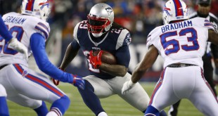 Nov 23, 2015; Foxborough, MA, USA; New England Patriots running back LeGarrette Blount (29) moves between Buffalo Bills free safety Corey Graham (20) and Buffalo Bills outside linebacker Nigel Bradham (53) during the second half at Gillette Stadium. Mandatory Credit: Winslow Townson-USA TODAY Sports