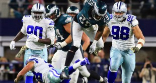 Nov 8, 2015; Arlington, TX, USA; Philadelphia Eagles running back DeMarco Murray (29) jumps over Dallas Cowboys strong safety Jeff Heath (38) during the overtime of a game at AT&T Stadium. Eagles won 33-27. Mandatory Credit: Ray Carlin-USA TODAY Sports
