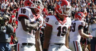 Georgia Bulldogs receiver Isaiah McKenzie (16) celebrates with safety Jarvis Wilson (19) after returning a punt for a touchdown during the fourth quarter at Jordan Hare Stadium. The Bulldogs beat the Tigers 20-13.