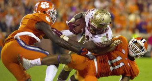 Nov 7, 2015; Clemson, SC, USA; Florida State Seminoles running back Dalvin Cook (4) is brought down by Clemson Tigers safety Travis Blanks (11) during the second half at Clemson Memorial Stadium. Tigers won 23-13. Mandatory Credit: Joshua S. Kelly-USA TODAY Sports