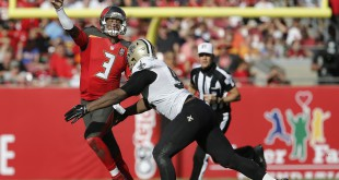 Tampa Bay QB Jameis Winston taking a hot from New Orleans LB. Courtesy of USA Today.