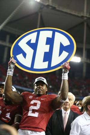 Dec 5, 2015; Atlanta, GA, USA; Alabama Crimson Tide running back Derrick Henry (2) shoes the SEC banner following their win 29-15 over the Florida Gators in the 2015 SEC Championship Game at the Georgia Dome. Mandatory Credit: Butch Dill-USA TODAY Sports