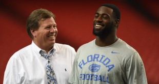 Florida defensive back Marcus Maye and head coach Jim McElwain share a laugh during walk-through in the Georgia Dome. (Greenberry Taylor/WUFT News)