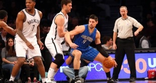 Dec 14, 2015; Brooklyn, NY, USA; Brooklyn Nets center Brook Lopez (11) defends Orlando Magic center Nikola Vucevic (9) during the third quarter at Barclays Center. Orlando Magic won 105-82. Mandatory Credit: Anthony Gruppuso-USA TODAY Sports