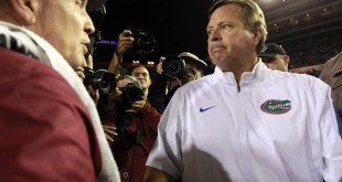 Nov 28, 2015; Gainesville, FL, USA; Florida Gators head coach Jim McElwain and Florida State Seminoles head coach Jimbo Fisher greet after the game at Ben Hill Griffin Stadium. Florida State defeated Florida 27-2.  Mandatory Credit: Kim Klement-USA TODAY Sports