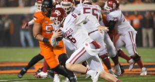 Nov 28, 2015; Stillwater, OK, USA; Oklahoma Sooners quarterback Baker Mayfield (6) runs the ball against the Oklahoma State Cowboys during the second half at Boone Pickens Stadium. Oklahoma won 58-23. Mandatory Credit: Rob Ferguson-USA TODAY Sports