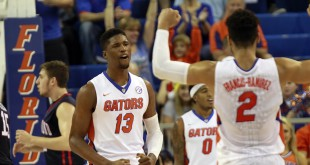 Dec 1, 2015; Gainesville, FL, USA; Florida Gators forward Kevarrius Hayes (13), guard Brandone Francis-Ramirez (2) react at the end of the first half against the Richmond Spiders at Stephen C. O'Connell Center. Mandatory Credit: Kim Klement-USA TODAY Sports