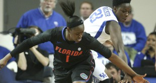 Jan 5, 2014; Lexington, KY, USA; Florida Gators guard Ronni Williams (1) battles for the ball with Kentucky Wildcats forward Samarie Walker (23) in the first half at Memorial Coliseum. Mandatory Credit: Mark Zerof-USA TODAY Sports