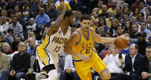Dec 8, 2015; Indianapolis, IN, USA; Golden State Warriors guard Klay Thompson (11) drives to the basket against Indiana Pacers forward Paul George (13) at Bankers Life Fieldhouse. Golden State defeats Indiana 131-123. Mandatory Credit: Brian Spurlock-USA TODAY Sports