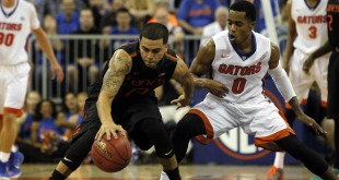 Nov 17, 2014; Gainesville, FL, USA; Miami Hurricanes guard Angel Rodriguez (13) dribbles the ball as Florida Gators guard Kasey Hill (0) defends during the first half  at Stephen C. O'Connell Center. Mandatory Credit: Kim Klement-USA TODAY Sports