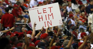 Jul 13, 2015; Cincinnati, OH, USA; A fan holds a sign referencing Pete Rose (not pictured) during the 2015 Home Run Derby the day before the MLB All Star Game at Great American Ballpark. Mandatory Credit: Rick Osentoski-USA TODAY Sports