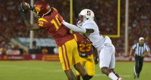 Sep 19, 2015; Los Angeles, CA, USA; Southern California Trojans receiver JuJu Smith-Schuster (9) is defended by  Stanford Cardinal cornerback Ronnie Harris (21) in the fourth quarter at Los Angeles Memorial Coliseum. Stanford defeated USC 41-31.  Mandatory Credit: Kirby Lee-USA TODAY Sports