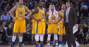 Golden State Warriors interim head coach Luke Walton (far right) stands with his team during the fourth quarter against the Toronto Raptors at Oracle Arena. The Warriors defeated the Raptors 115-110. Mandatory Credit: Kyle Terada-USA TODAY Sports